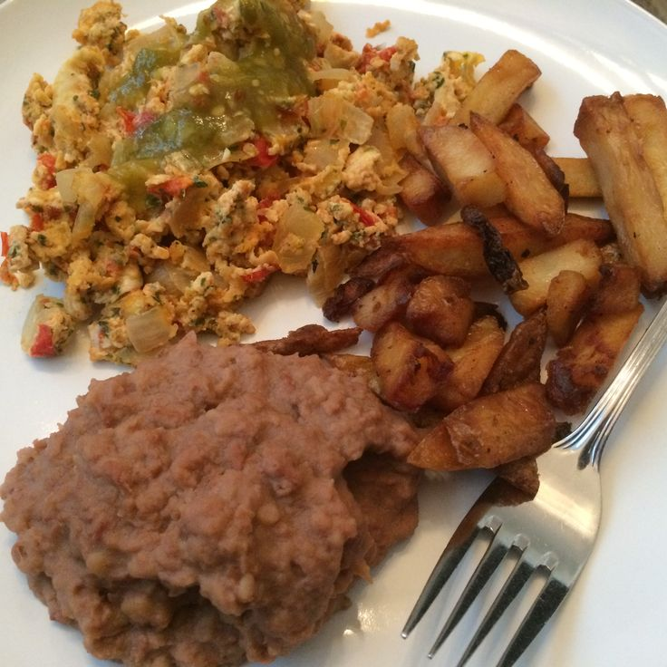Mexican Scramble eggs, fries and refried beans