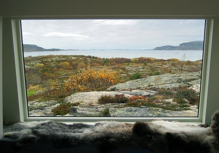 """On a flat rock by the Atlantic Ocean, Fantastic Norway has created their version of the traditional """"cluster yard"""" in a solution that combines the panoramic view with shelter from the wild weather."""