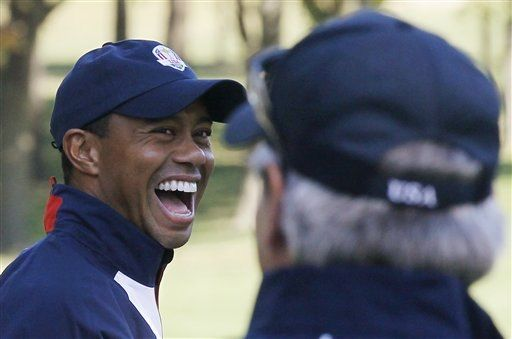 USA's Tiger Woods, left, laughs as he talks to Fred Couples at the Ryder Cup PGA golf tournament Thursday, Sept. 27, 2012, at the Medinah Country Club in Medinah, Ill. (AP Photo/Charles Rex Arbogast)