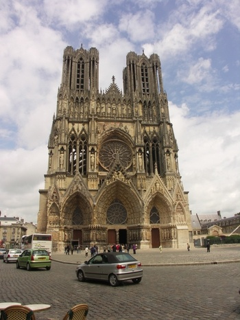 """The kings of France were once crowned in Reims Cathedral. Along with the cathedrals of Chartres and Amiens, Reims is a member of the illustrious triad of """"High Gothic"""" or """"Classical"""" French cathedrals built in the 13th century."""