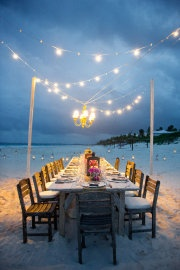 strung lights and chandelier for small intimate party on the beach.. so romantic!