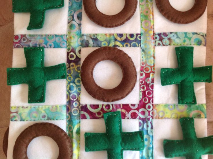 Noughts and crosses game created by Julie Farmer.