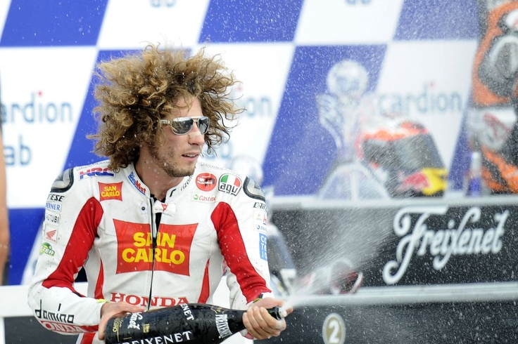 The late Marco Simoncelli celebrated his first MotoGP podium at Brno in 2011. He was so much fun to watch racing, he is greatly missed in motogp.