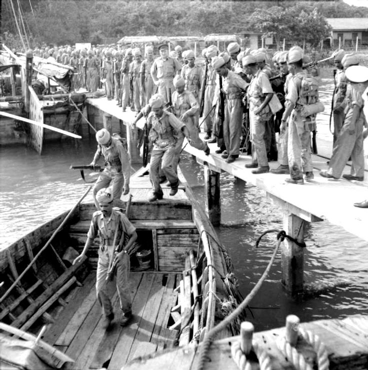 Allied Indian troops embark onto boats during an invasion exercise during the Malayan Campaign. Kota Tinggi, Johore, British Malaya (now, Malaysia). 13 November 1941.