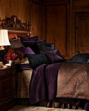 "Ralph Lauren ""New Bohemian"" Bed Linens - Jewel toned paisley duvet cover bed skirt and pillow sham, purple quilt stitched in a paisley design - masculine bedroom with pine(?) paneling"
