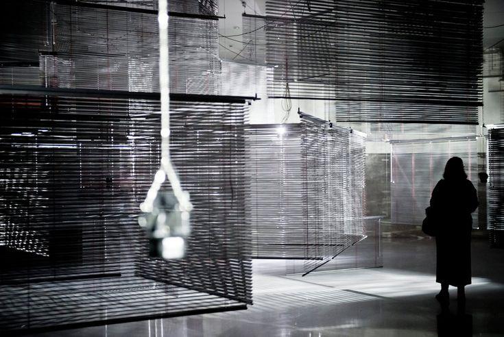A-visitor-looks-at-an-installation-entitled-Citadella-by-South-Korean-artist-Haegue-Yang.jpg (956×640)