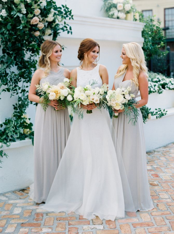 Elegant gray bridesmaid gowns: http://www.stylemepretty.com/2016/03/15/neutral-elegant-outdoor-wedding-inspiration/ | Photography: Greer Gattuso - http://www.greergphotography.com/
