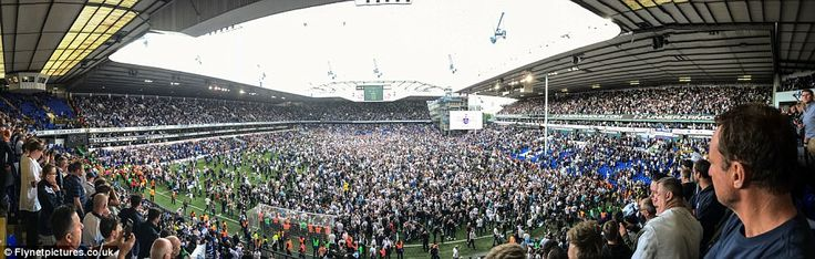 A panoramic view of the pitch invasion at the end of the final game at White Hart Lane on ...