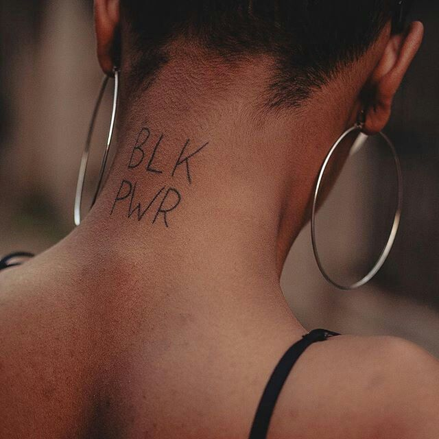 simple black power tattoo