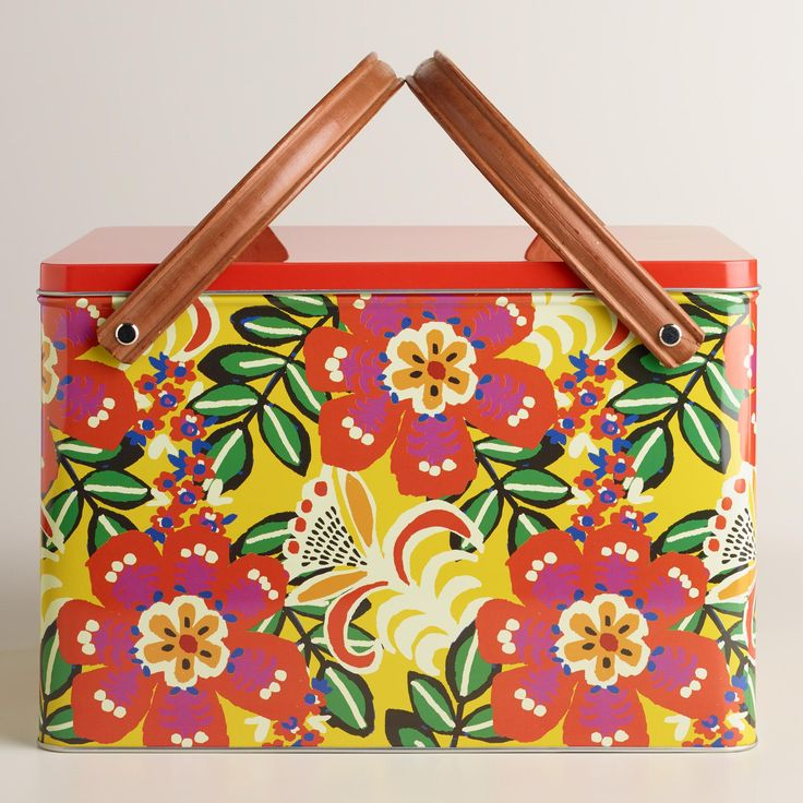 Crafted of metal in retro, mid-century modern style, our exclusive picnic basket features a glamorous Cuban-inspired tropical pattern that sets the mood for fun in the sun.