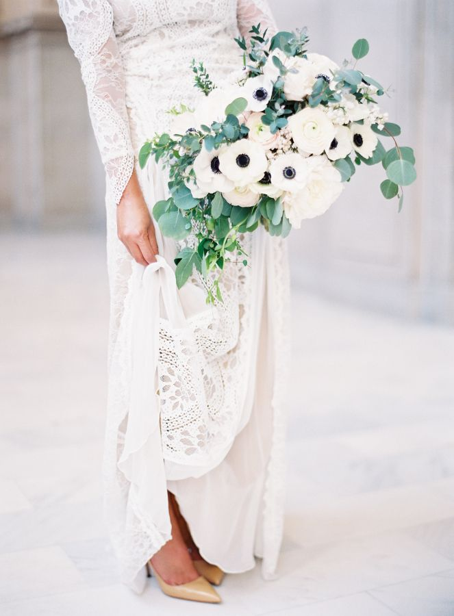 Modern white anemone bouquet: http://www.stylemepretty.com/california-weddings/san-francisco/2016/07/01/all-the-reason-to-get-married-at-city-hall/ | Photography: Esmeralda Franco - http://esmeraldafranco.com/