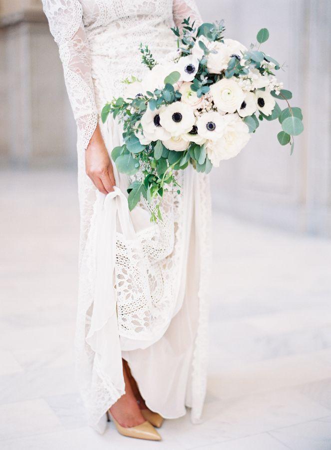 Modern white anemone bouquet: http://www.stylemepretty.com/california-weddings/san-francisco/2016/07/01/all-the-reason-to-get-married-at-city-hall/   Photography: Esmeralda Franco - http://esmeraldafranco.com/