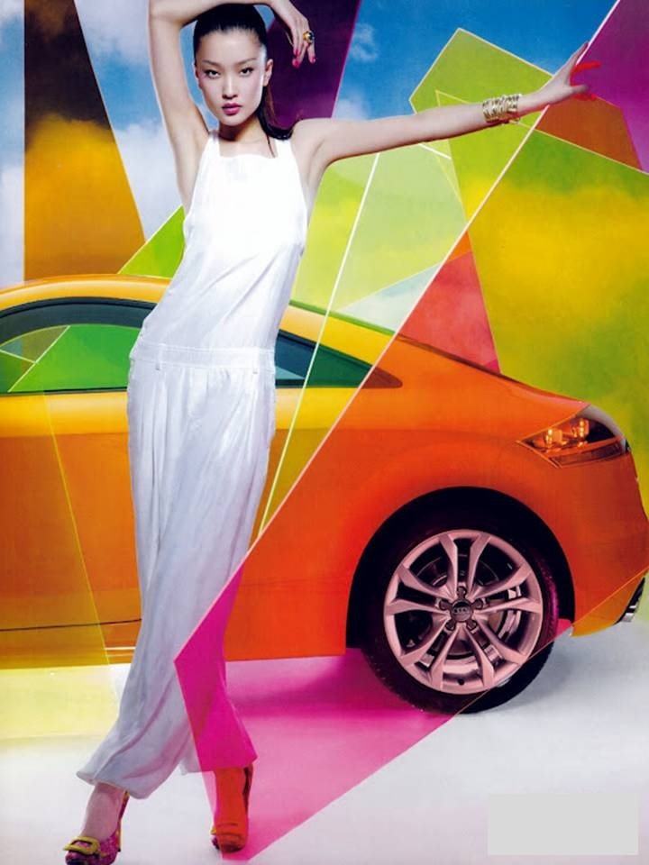 Du Juan (in Max Mara) photographed by Feng Hai for Vogue China. (Background: Audi TTS Coupé)