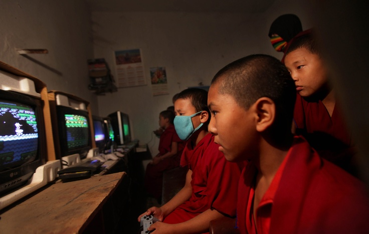 Young Buddhist monks play video games at a parlor in the town of Bodh Gaya, ahead of the Kalachakra Buddhist festival in Bihar, India,on December 29, 2011. (AP Photo/Altaf Qadri)