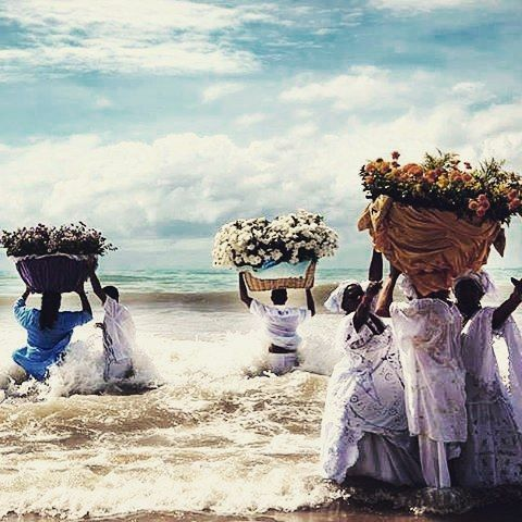 flower offerings for Yemanjá, queen of the sea, feminine principle of creation