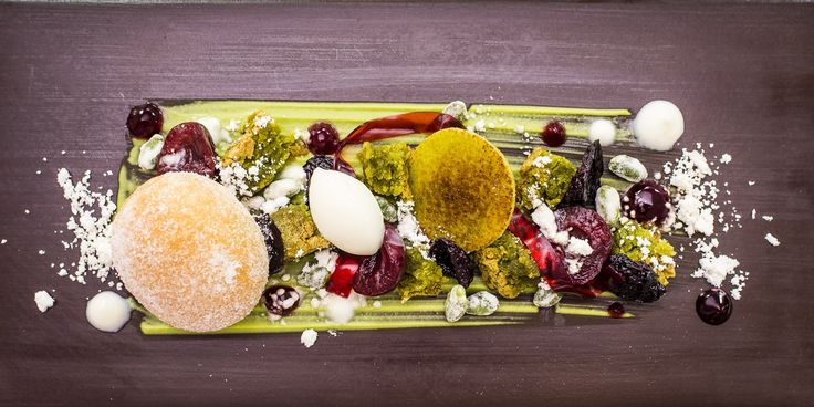 Michael Wignall's dessert is a truly spectacular dish, comprised of multiple cherry, pistachio and yoghurt elements and served with a warm doughnut a disc of marzipan.
