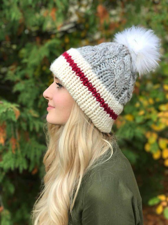 b09b82b0734 THE SOCK MONKEY HAT GREY CABLED HAT WITH RED STRIPE w  FAUX FUR POM POM -  Knit with a soft wool-blend yarn - Faux Fur pom pom in colour Brown Wolf  (pom ...
