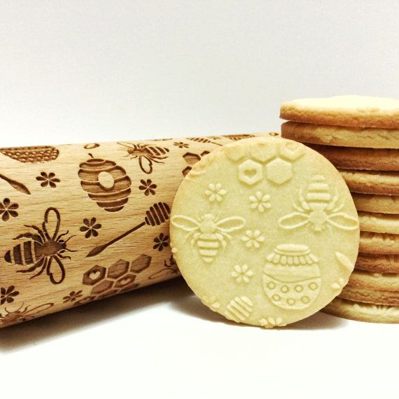 This wooden rolling pin is engraved with Bee pattern.  This design is a fun way to enhance home-made cookies or even texturize hand-made pottery. This