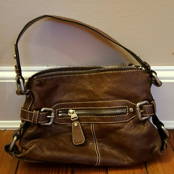 Fossil Brown purse Fossil dark brown purse in great condition. Used a couple years ago but not many times. Perfect size - not too big, not too small. Fossil Bags