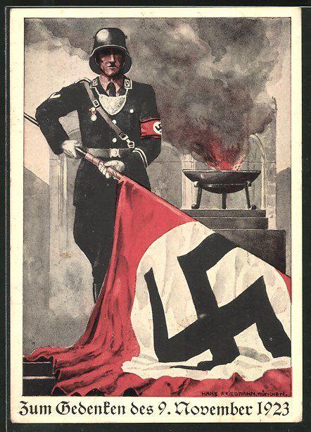old postcard: AK Zum Gedenken des 9. November 1923, Hitlersputsch, SS-Mann in Uniform mit Hakenkreuzfahne