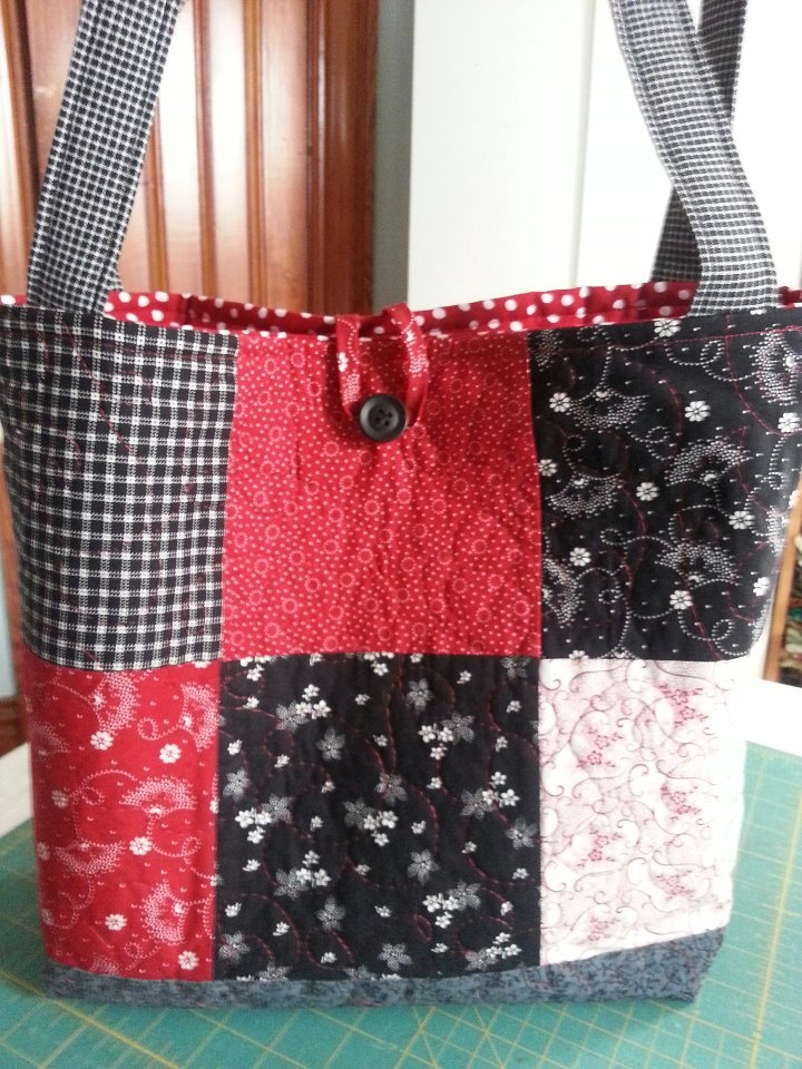 I made this bag using 12- 6 inch squares of fabric, plus fabric for the bottom piece, lining, pockets and handles. I quilted the front and back. The tutorial to make this bag is from Missouri Star Quilt Company on Youtube.com
