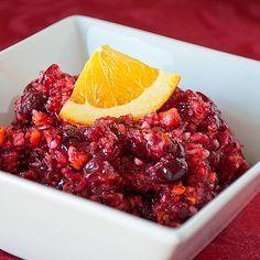 Cranberry-Orange Relish  2 (12 oz) bags fresh cranberries  2 oranges  1 cup sugar