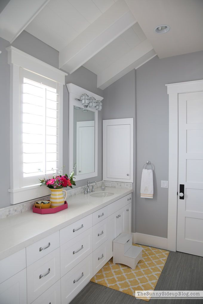 """My girls' bathroom is also painted in """"Seattle."""" I had a different color ready for this room and just like the mudroom, I changed my mind at the last minute and decided to keep it neutral.coastal-bathroom1"""