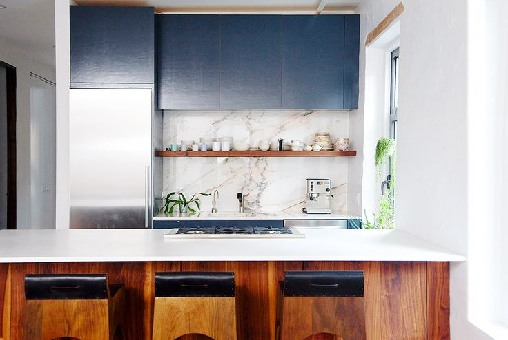 like the marble backsplash in contrast to plain counter, also like wood feature underneath island