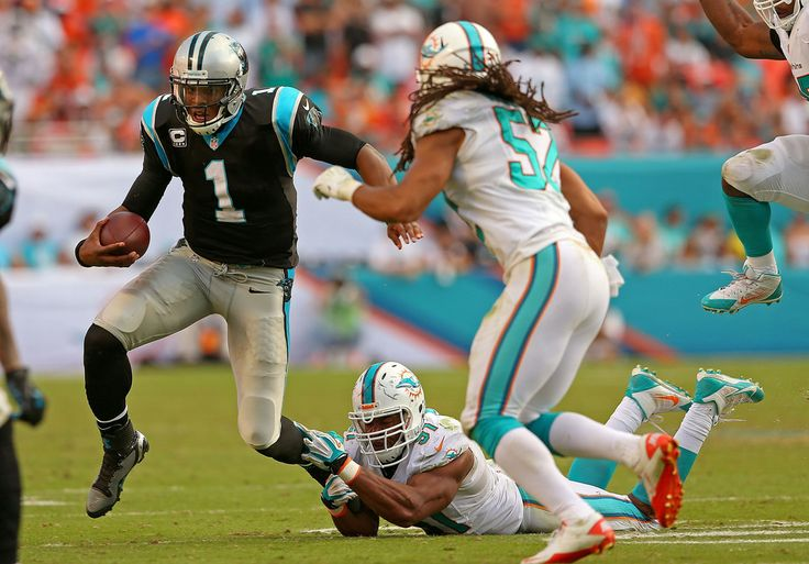 Cam Newton #1 of the Carolina Panthers scrambles during a game against the Miami Dolphins at Sun Life Stadium on November 24, 2013 in Miami Gardens, Florida.
