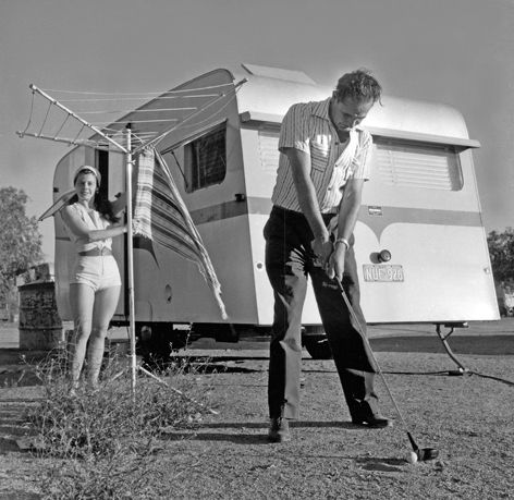 Sorlies' Couple, Broken Hill, 1959, by Jeff Carter.   Time out for performers from Sorlies Travelling Vaudeville Show, a popular attraction for more than half a century.   Find more detailed information about this photograph: http://www.sl.nsw.gov.au/events/exhibitions/2011/beach_bush_battlers/items/image05.html  From the collection of the State Library of New South Wales:  www.sl.nsw.gov.au