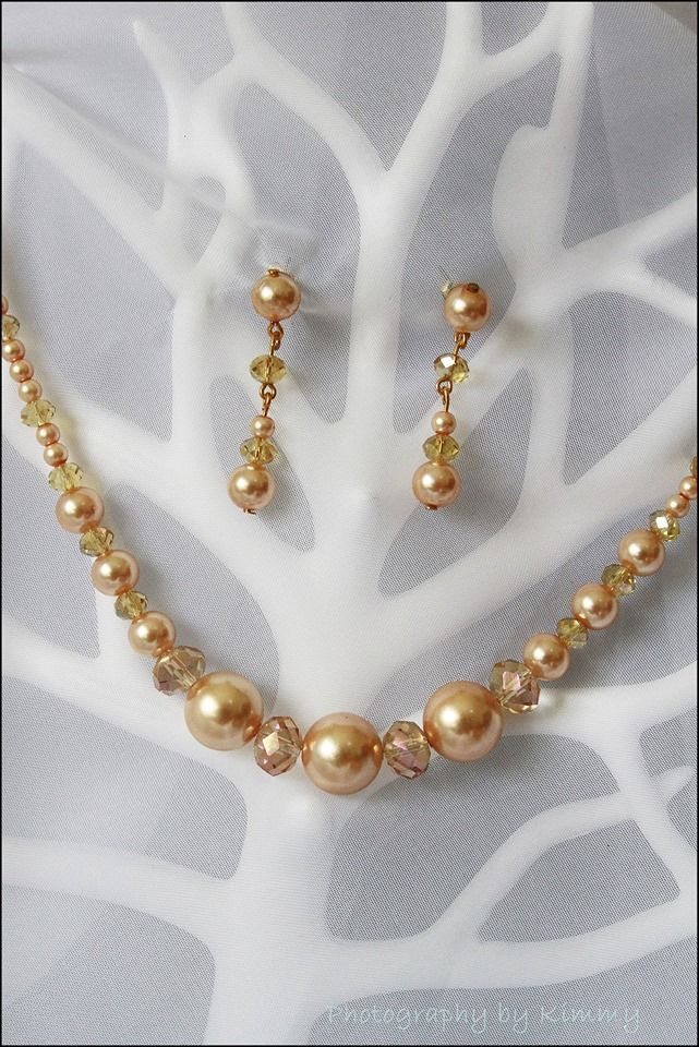 Champagne gold painted glass pearls with crystal rondels. Necklace and earring set