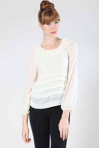 white top with ruffle neckline $38  www.thefactoryboutique.com