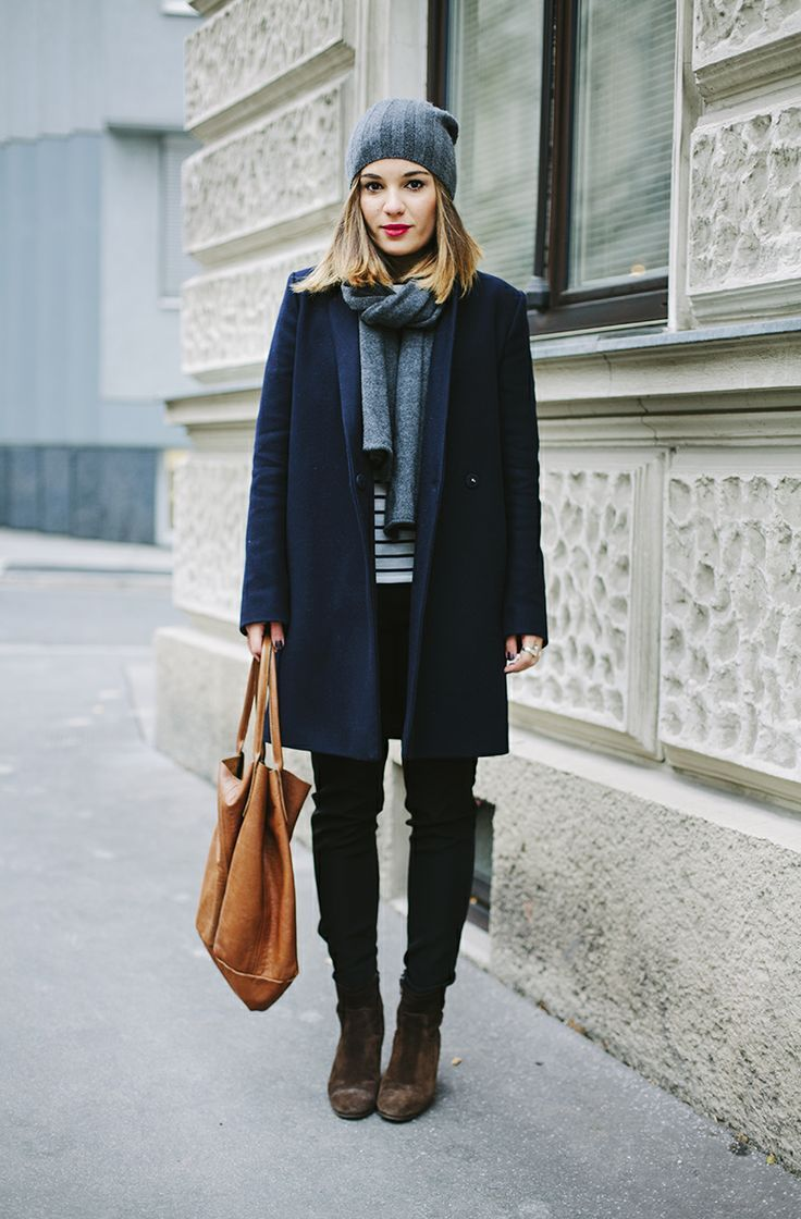 love this look with stripes & multiple neutrals: brown boots & bag, black pants, navy coat, gray scarf & hat