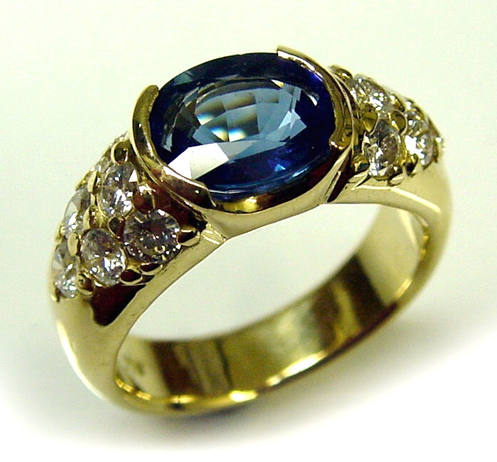 Chibnalls custom 18ct gold Natural Ceylon Sapphire and Diamond dress ring.