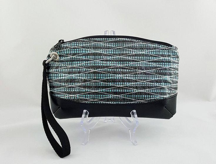 Aquamarine Recycled Sailcloth Wristlet, Anchor Lining, Carbon Fiber Laminate Sailcloth, Recycled Sail Bag, Nautical Bag, Nautical Gift, Aqua by AlteredSails on Etsy https://www.etsy.com/listing/559895410/aquamarine-recycled-sailcloth-wristlet  #aquamarine #aqua #teal #turquoise #wristlet #sailcloth #anchors #nautical #recycledsails #repurposed #nauticalstyle #sails #clutch #unique