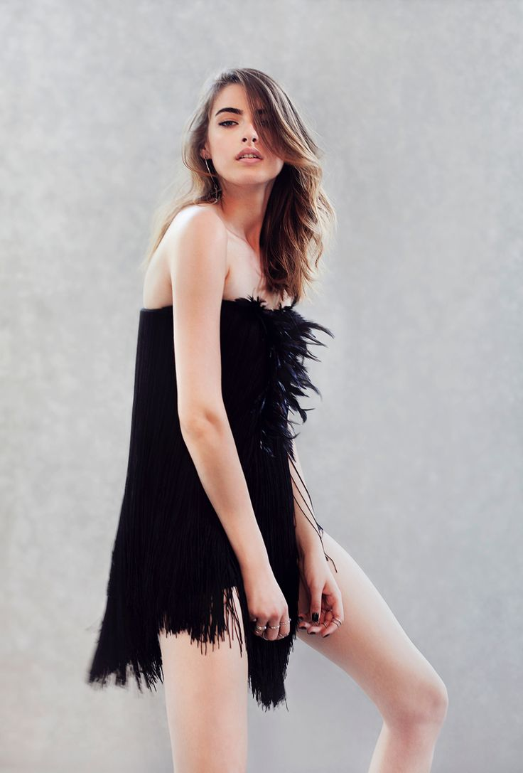 http://manuri.ro/product/manuri-jumpsuit-with-feathers-and-fringes/