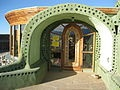 A vaulted earthship  home entrance