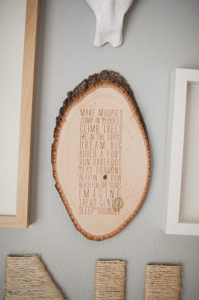 i love the idea of using a piece of tree trunk, but put our wedding vows or lyrics from our first dance on it since it perfectly fits my wedding theme!