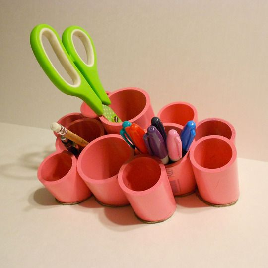 """Here's How to Make Your Own Plastic Pipe Desk Organizer - I don't think I can hold back my desire to call these """"totally tubular"""", but don't let my groan-worthy pun stop you from admiring the DIY handiwork of Studio C's modern desk organizer made from PVC pipe, some spray paint, and a few dollops of Liquid Nails.."""