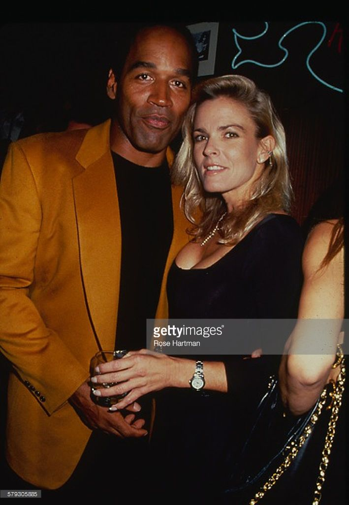 Portrait of American former foorball player OJ Simpson and his wife, Nicole Brown (1959 - 1994), as they attend a party at the Harley Davidson Cafe, New York, New York, 1993. Simpson was tried for the murder of his wife (on June 12, 1994) and, though he was acquitted in the murder trial, he was found guilty of wrongful death in a subsequent civil suit--still later, he was found guilty of other felony charges (unrelated to the murder) and convicted in 2008.