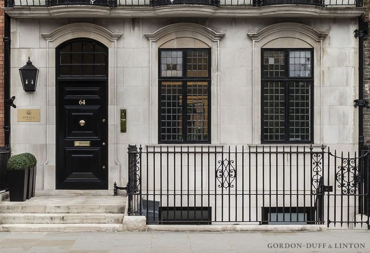 6-storey Portland stone townhouse converted into single office on Sloane Street. Black window frames.