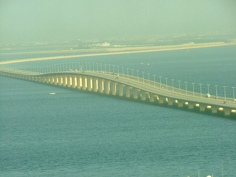 The King Fahd Causeway is multiple dike - bridge combination connecting Khobar, Saudi Arabia, and the island nation of Bahrain.