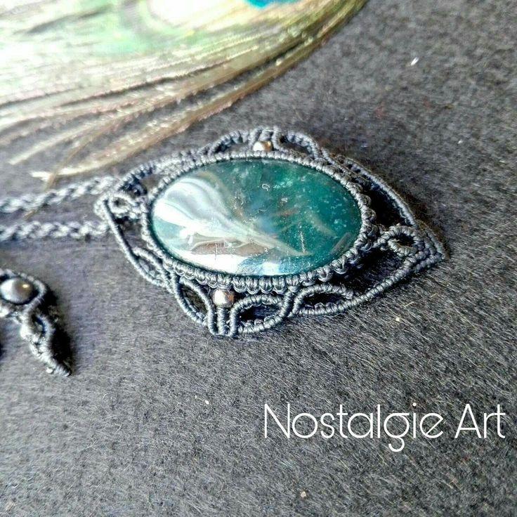 Macrame wrapped pendant with gemstone .