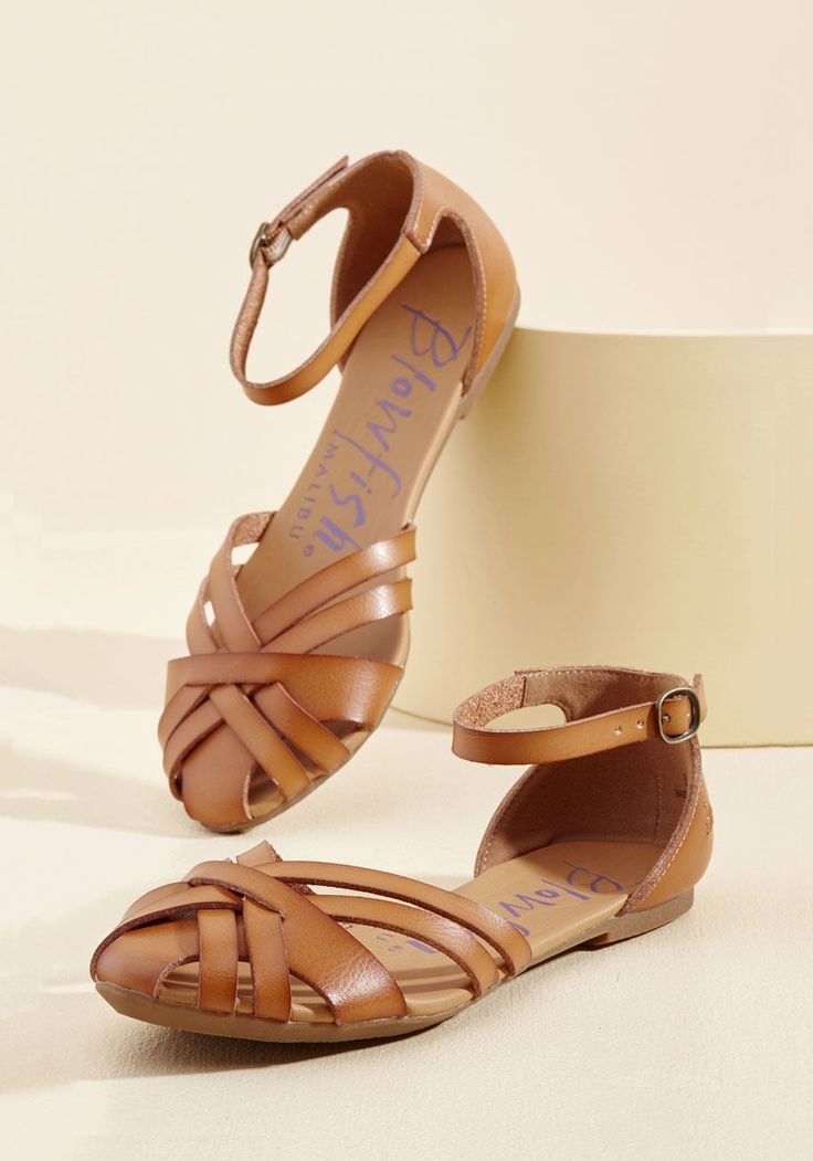 <p>The best time to introduce a new locale to your lovely style is when the sun can shine a spotlight on your faux-leather flats from Blowfish! With buckled ankle bands and a series of straps at each toe, this caramel-colored pair draws attention to your perfected travel wardrobe.</p>
