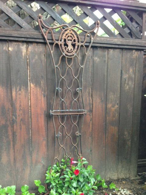 You could add this to your cabin garden - these sewing machine legs arent too hard to find: New Garden Trellis- bolted 2 vintage Singer sewing machine legs together.......