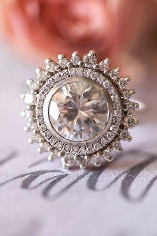 Giant round diamond engagement ring