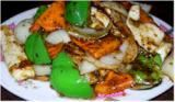 Cantonese Cuisine: Squid in black bean sauce, made with Chinese salted black beans, is a typical Cantonese dish.