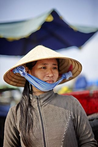 Woman selling coffee, floating market on Mekong river, Long Xuyen, An Giang Province, Vietnam