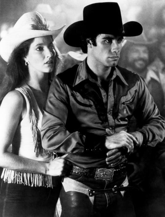 URBAN COWBOY (1980) - John Travolta & Madolyn Smith - Paramount Pictures - Movie Still.
