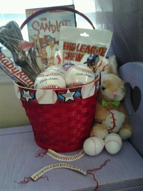 Boys Baseball Easter basket. The Sandlot, Baby Ruth candy bar, Big Leqgue Chew. All the other candy is under the grass. The basket was a little too small...I also made bracelets out of a baseball. My son is a pitcher and his daddy coaches his team so they will have matching father/son pitcher/coach bracelets!  By Angela Ford